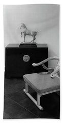 A Chair, Bedside Cabinet And Sculpture Of A Horse Bath Towel