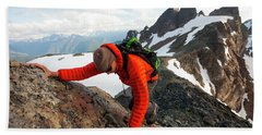 A Climber Scrambles Up A Rocky Mountain Hand Towel