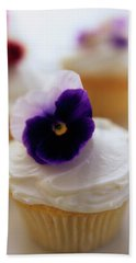 A Cupcake With A Violet On Top Bath Towel