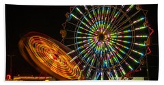 Bath Towel featuring the photograph Colorful Carnival Ferris Wheel Ride At Night by Jerry Cowart