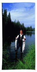 A Female Angler Holds Two Silver Coho Bath Towel