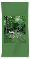 A Garden With Checkered Pavement Hand Towel