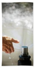 A Hand In A Playground Sprinkler Hand Towel