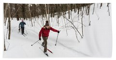 A Man And Woman Cross Country Skiing Hand Towel
