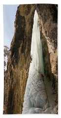 A Man And Woman Ice Climbing A Frozen Hand Towel
