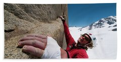 A Man Rock Climbs In The Chilean Andes Hand Towel