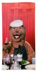 A Person In Bear Costume Holds A Drink Hand Towel