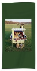 A Picnic Table Set Up On The Back Of A Car Bath Towel
