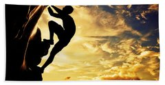 A Silhouette Of Man Free Climbing On Rock Mountain At Sunset Bath Towel