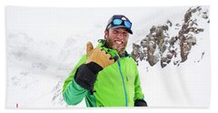A Skier Smiles During A Sunny Day Hand Towel