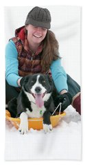 A Smiling Young Woman Rides A Sled Hand Towel