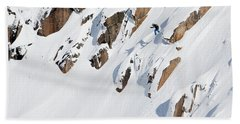A Snowboarder Jumping Off A Cliff Hand Towel