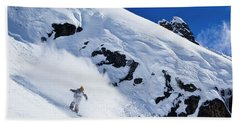 A Snowboarder Slashes Powder Snow Hand Towel