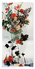 A Studio Shot Of A Vase Of Flowers And A Garden Hand Towel