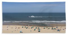 A Touring Speedboat Passes By Shore In Ocean City Maryland Hand Towel