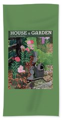 A Watering Can And A Shovel By A Flower Bed Hand Towel