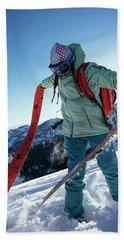 A Woman Backcountry Skiing Hand Towel