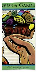 A Woman Holding A Basket Of Fruit Hand Towel