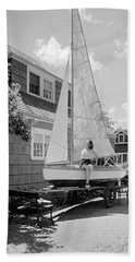 A Woman On Sailboat At Home Hand Towel