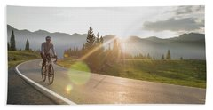 A Woman Road Biking On Highway 550 Hand Towel
