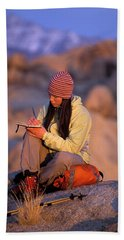 A Woman Sits And Writes In Her Journal Hand Towel