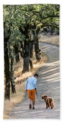 A Woman Takes Her Dog For A Walk Hand Towel