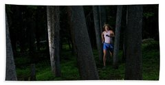 A Woman Trail Running In The Forests Hand Towel