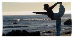 A Yong Woman Stretches Trough A Yoga Bath Towel