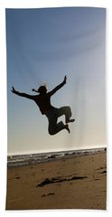 A Young Woman Leaps In The Air While Bath Towel