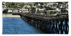 Hand Towel featuring the photograph Along The Pier by Michael Gordon