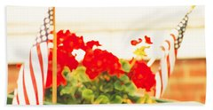 American Flags And Geraniums In A Wheelbarrow One Bath Towel by Marian Cates