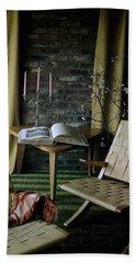 An Armchair Beside A Table And An Old Book Bath Towel