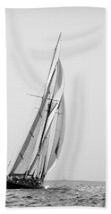 A Tall Ship In Mediterranean Water Approaching To Lighthouse Of Isla Del Aire - Menorca Bath Towel