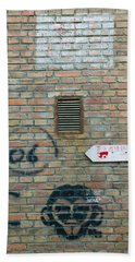 Art And Signs Painted On A Brick Wall Hand Towel