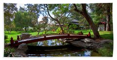 Hand Towel featuring the photograph Bridge Over Japanese Gardens Tea House by Jerry Cowart