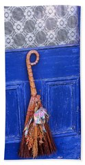 Bath Towel featuring the photograph Broom On Blue Door by Rodney Lee Williams