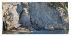 Hand Towel featuring the photograph Cave By The Sea by George Katechis