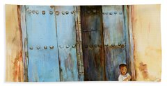 Child Sitting In Old Zanzibar Doorway Bath Towel by Sher Nasser