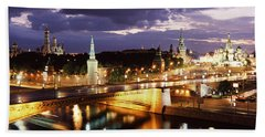 City Lit Up At Night, Red Square Hand Towel by Panoramic Images