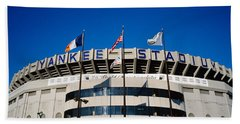 Flags In Front Of A Stadium, Yankee Hand Towel by Panoramic Images