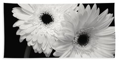 Bath Towel featuring the photograph Gerbera Daisy Sisters by Jeannie Rhode