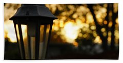 Bath Towel featuring the photograph Lamplight by Photographic Arts And Design Studio