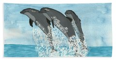 Hand Towel featuring the painting Leaping Dolphins by Tracey Williams