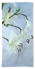Bath Towel featuring the photograph Lilies On Blue by Louise Kumpf