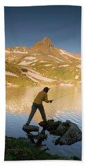 Man Fishing In Ice Lake Hand Towel