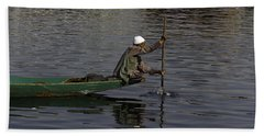 Man Plying A Wooden Boat On The Dal Lake Bath Towel