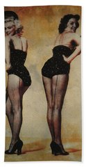 Marilyn Monroe And Jane Russell Hand Towel by EricaMaxine  Price