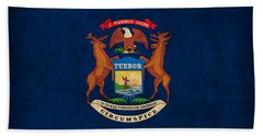 Michigan State Flag Art On Worn Canvas Hand Towel by Design Turnpike