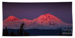 Morning Dawn On Two Of Three Sisters Mountain Tops In Oregon Bath Towel by Jerry Cowart