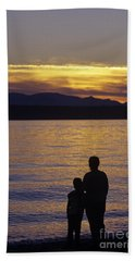 Mother And Daughter Holding Each Other Along Edmonds Beach At Su Bath Towel